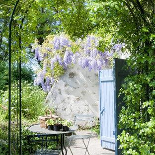 Exemple d'une terrasse nature avec aucune couverture et une dalle de béton.