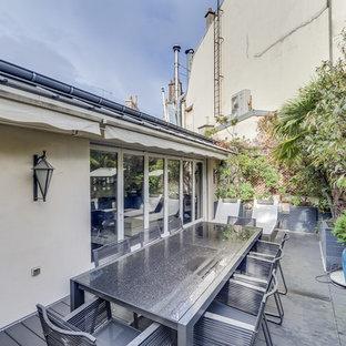 Foto de terraza marinera, de tamaño medio, en azotea, con toldo y cocina exterior