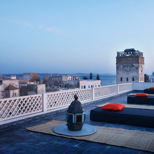 Deck - large mediterranean rooftop deck idea in Paris with no cover