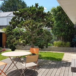 Idée de décoration pour une terrasse et balcon arrière design.