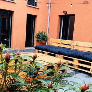 Idee per un piccolo patio o portico industriale in cortile