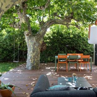 Idées déco pour une petite terrasse contemporaine avec aucune couverture.