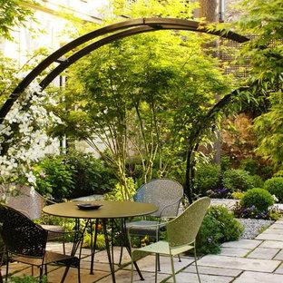Patio - shabby-chic style patio idea in Paris