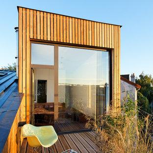 Cette image montre un toit terrasse sur le toit design de taille moyenne.