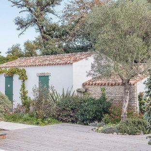 Inspiration pour une terrasse arrière méditerranéenne avec aucune couverture.