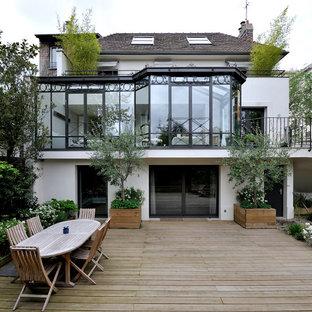 Aménagement d'une terrasse avec des plantes en pots arrière contemporaine de taille moyenne avec aucune couverture.