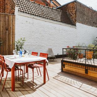 Aménagement d'une terrasse classique avec aucune couverture.