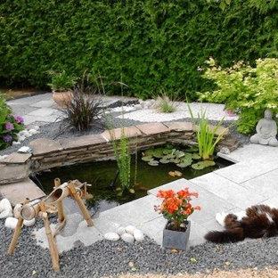 Idee per un patio o portico etnico con graniglia di granito