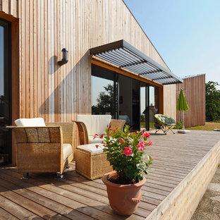Idée de décoration pour une terrasse design.