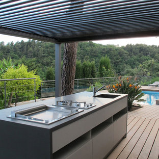 This is an example of a mediterranean terrace and balcony in Nice with an outdoor kitchen.