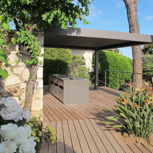 Large mediterranean back terrace and balcony in Nice with an outdoor kitchen and a pergola.