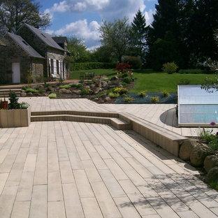Foto di un grande patio o portico design dietro casa con nessuna copertura e pavimentazioni in cemento