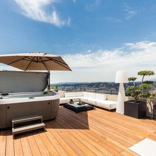 Réalisation d'une terrasse design avec aucune couverture.