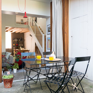 Patio - scandinavian backyard concrete patio idea in Bordeaux with no cover