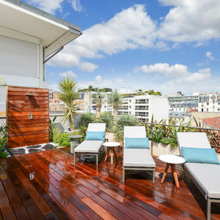 Aménagement d'une terrasse sur le toit contemporaine avec aucune couverture.