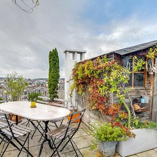 Inspiration pour une terrasse sur le toit méditerranéenne de taille moyenne avec aucune couverture.