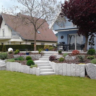 Design ideas for a back patio in Strasbourg with natural stone paving and an awning.