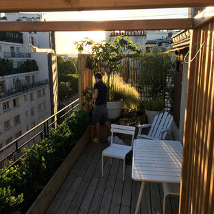 Deck container garden - mid-sized shabby-chic style rooftop deck container garden idea in Paris with a pergola