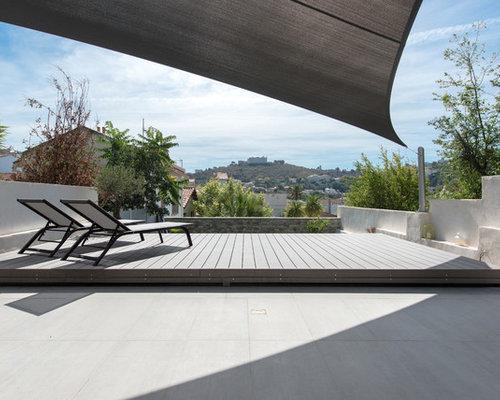 photos et id es d co de terrasses avec un auvent. Black Bedroom Furniture Sets. Home Design Ideas