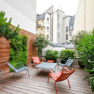 Ispirazione per una terrazza minimal di medie dimensioni e sul tetto con nessuna copertura