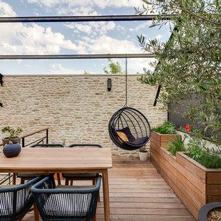 Exemple d'une terrasse sur le toit tendance.
