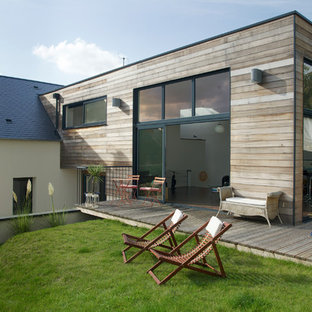 Idées déco pour une terrasse avec des plantes en pots latérale contemporaine de taille moyenne avec aucune couverture.
