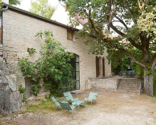 Foto e idee per arredare una casa in campagna digione for Piani casa di campagna con avvolgente portico