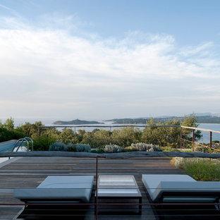 Idées déco pour une très grande terrasse contemporaine.
