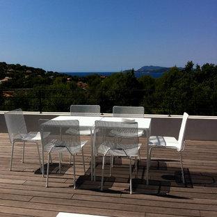 Réalisation d'une terrasse et balcon design de taille moyenne.