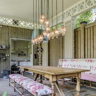 Inspiration för stora lantliga terrasser, med utekök