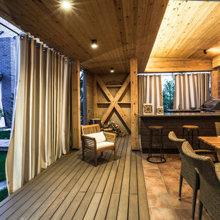 Example of a danish outdoor kitchen deck design in Moscow
