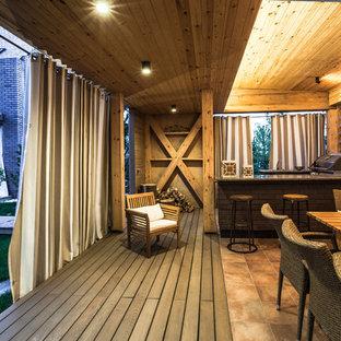 На фото: террасы в скандинавском стиле с летней кухней