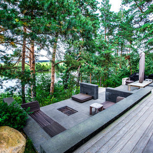 Новые идеи обустройства дома: терраса на заднем дворе в стиле рустика