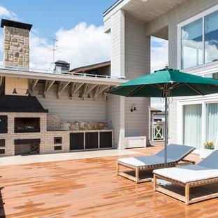 Неиссякаемый источник вдохновения для домашнего уюта: большая терраса на боковом дворе в классическом стиле с местом для костра и навесом
