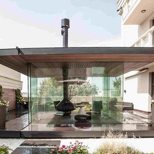 Источник вдохновения для домашнего уюта: фонтан на террасе на крыше, на крыше в современном стиле с навесом