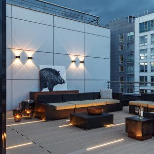 Стильный дизайн: большая терраса на крыше в современном стиле - последний тренд