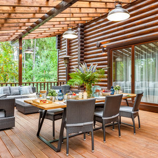 Large rustic side terrace and balcony in Moscow with a pergola.