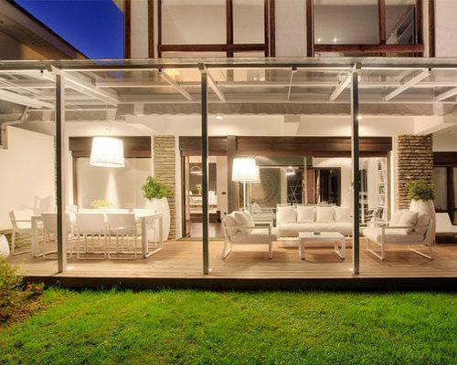 Adosado moderno con buhardilla terraza y jard n for Decoracion jardin adosado