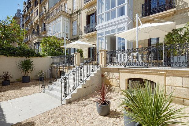 Contemporáneo Terraza y balcón by Inaki Caperochipi Photography