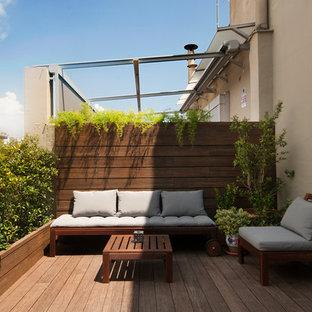 Diseño de terraza exótica, de tamaño medio, sin cubierta, en azotea, con jardín de macetas