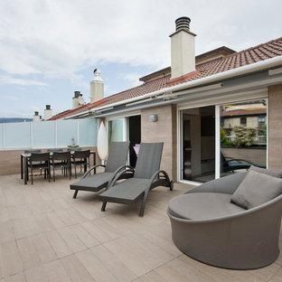 Diseño de terraza contemporánea, de tamaño medio, sin cubierta, en azotea, con jardín de macetas