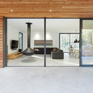 Deck - large scandinavian backyard deck idea in Other
