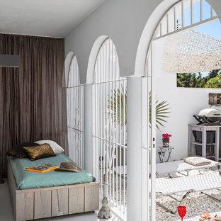 Idée de décoration pour une terrasse bohème.