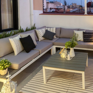 Photo of a medium sized scandinavian roof terrace in Madrid with an awning.