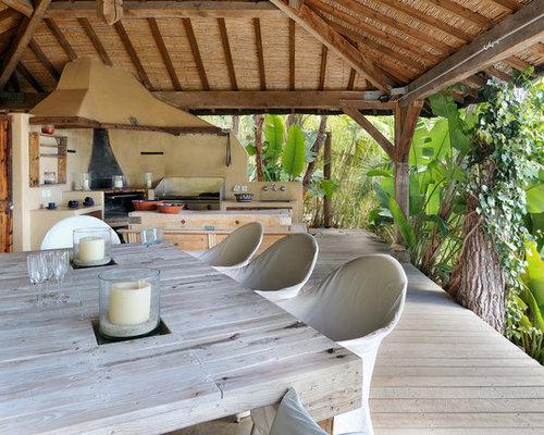 Grand Foyer Exterieur : Extérieur avec une terrasse en bois pergola et un