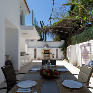 This is an example of a large mediterranean back terrace and balcony in Other with an outdoor kitchen and no cover.
