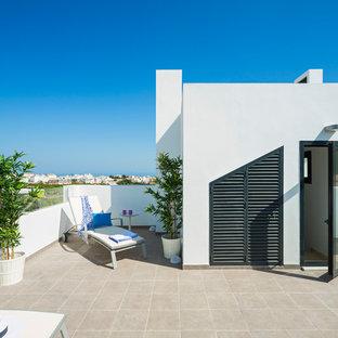 Diseño de terraza costera, de tamaño medio, en azotea
