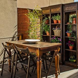 Imagen de terraza tradicional renovada, pequeña, sin cubierta, en azotea, con jardín de macetas