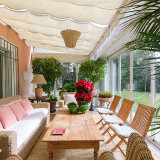This Is An Example Of A Large Shabby Chic Style Screened In Back Porch