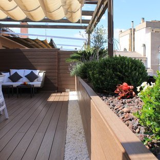 Photo of a medium sized mediterranean roof terrace in Other with a potted garden and an awning.